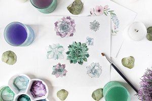 Workspace with watercolor painting