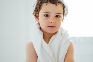 Kid with towel after bath
