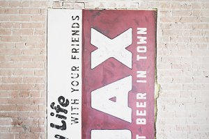 Old Beer Sign on a Brick Wall