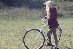 stylish girl with a bicycle
