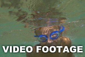 Boy in Goggles Swimming