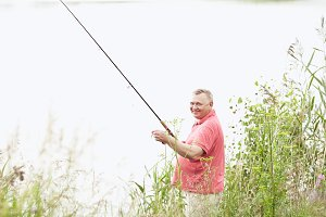 Mature angler on lake
