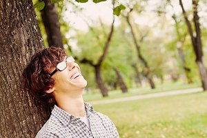 Laughing teenager in park