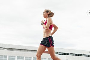 Woman Track Athlete Running On Track