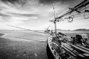 Fisherman boat on sand beach.
