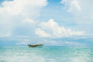 Lonely boat in ocean