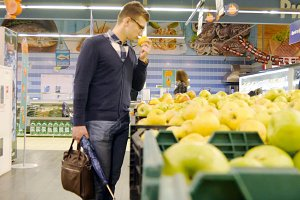 Man choose products in the hypermarket
