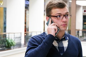 Man in glasses talking on phone