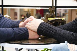 couple holding each other hands