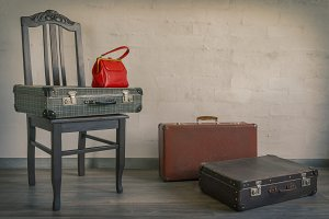Old suitcases and red bag