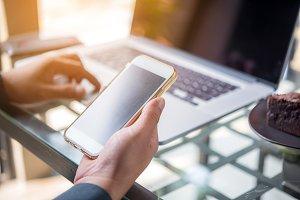 Smart phone in businessman hand