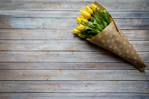 Yellow Tulips on a Wooden Background