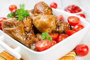 Fried chicken legs with sesame seeds