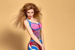 Fashion beauty woman in bright clothes.Expressive