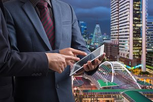 Businessmen using touchpad