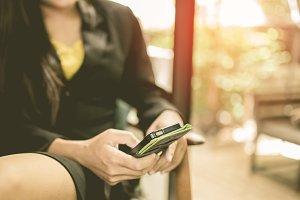 Woman hand using smartphone