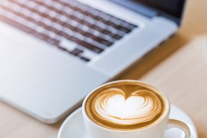 Coffee cup , laptop