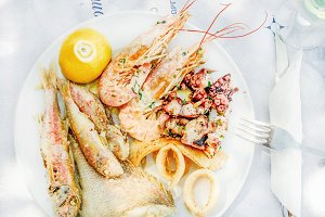 Cooked seafood on plate with lemon