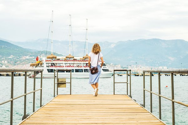 Young woman on pier