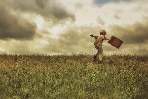 Boy Running Up a Hill