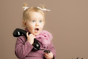 Baby girl in surprise talking phone