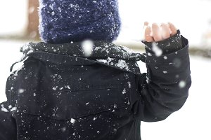 Little Boy Throwing Snowball