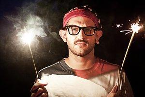 Patriotic Man Holding Sparklers