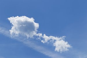 White clouds in the blue sky, sunshine