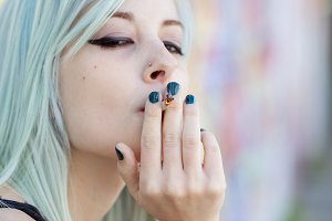 Defiant young woman smoking