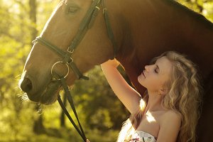 blonde with a horse