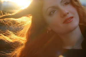 redhead woman and sunlight