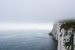 Fog over English cliffs