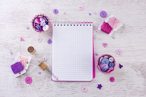 notebook with sewing items