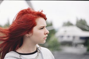 Young schoolgirl model with red hair
