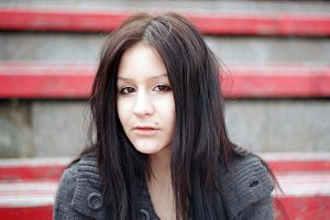 The sad beautiful girl student