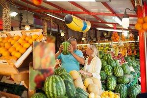 Elderly couple in market