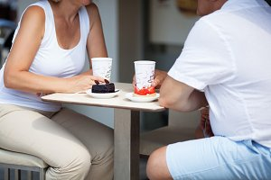Couple Enjoying Coffee and Desserts