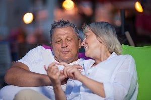 Loving middle-aged couple having