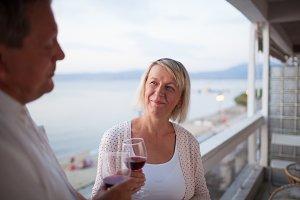 Senior woman drinking wine