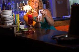 Attractive woman celebrating