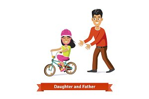 Father and daughter on the bike