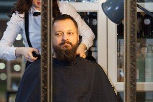 Man having his beard and hair