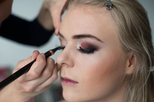 Make-up artist prepearing model