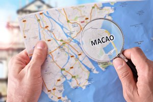 Man consulting Macao map