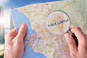 Man consulting Kuala Lumpur map
