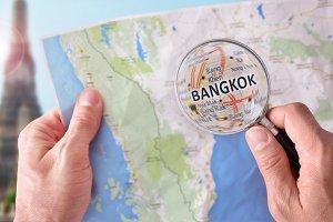 Man consulting Bangkok map