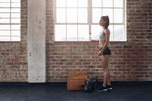 Young female standing at gym
