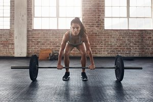 Female performing deadlift exercise