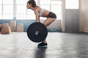 Fitness woman doing weightlifting