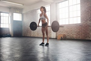 Fit female athlete lifting weights